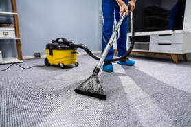 man cleans the dirty mat
